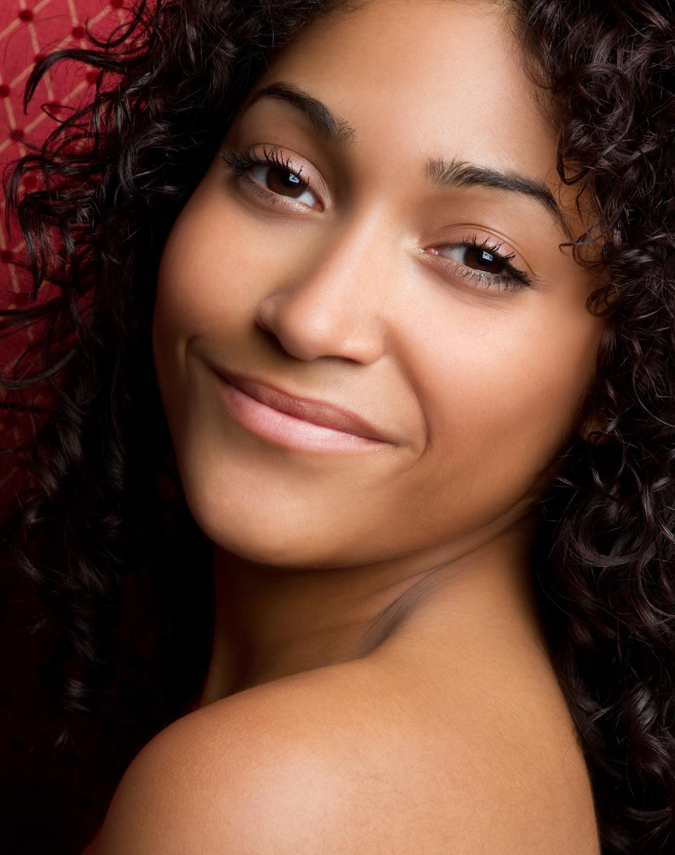 Beautiful smiling african american woman - organic cosmetics